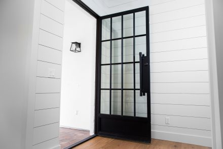 Modern Iron Entry Door by First Impression Ironworks
