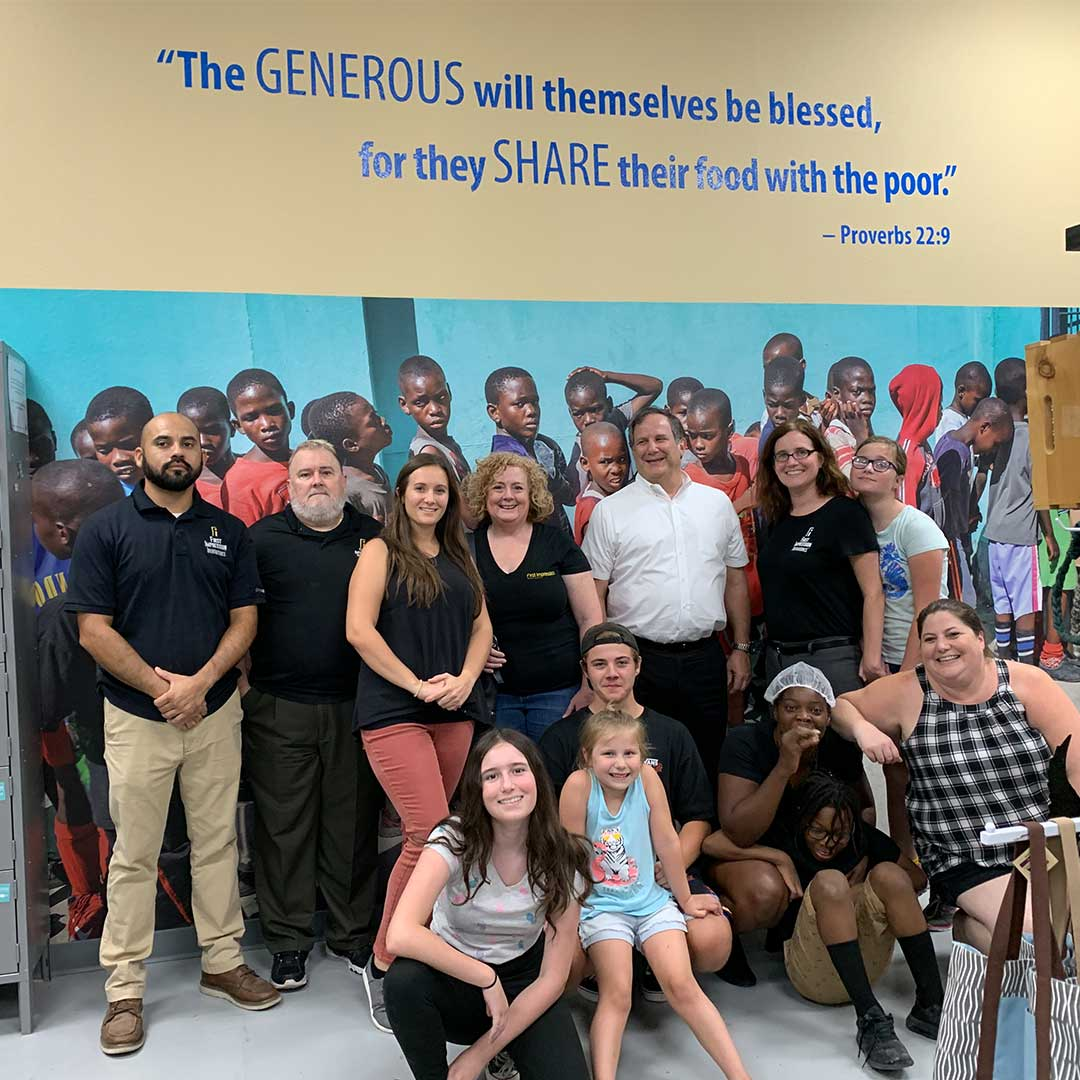 First Impression Ironworks Employees Group Picture at Feed My Starving Children