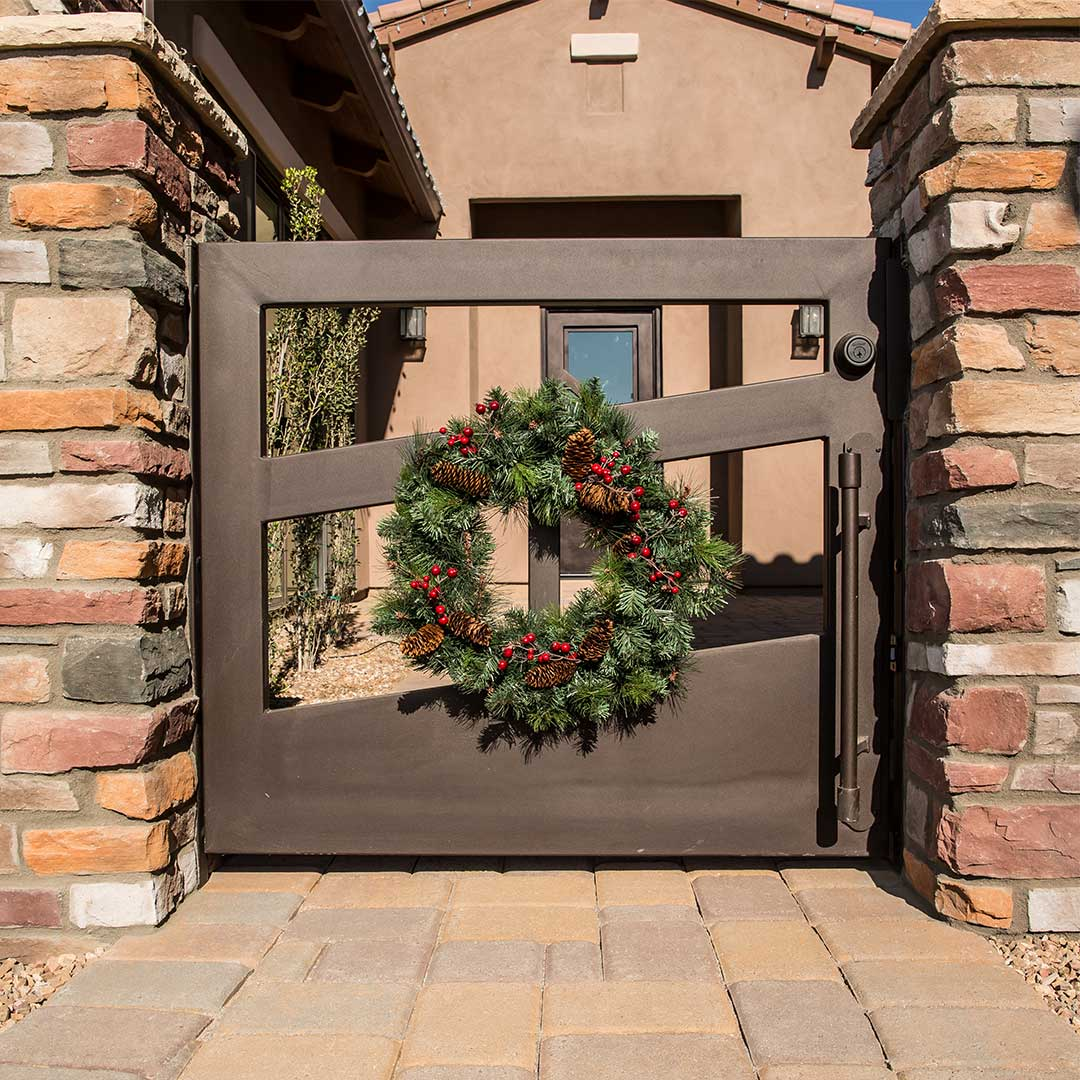 Iron Courtyard Gate with Holiday Wreath