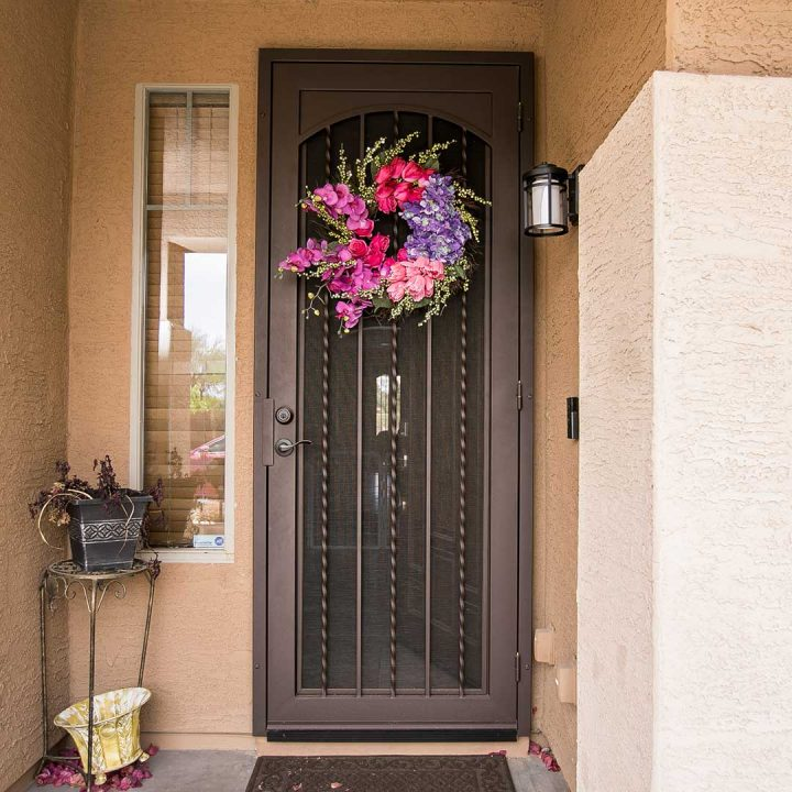 Royale iron security door with wreath hanging on it