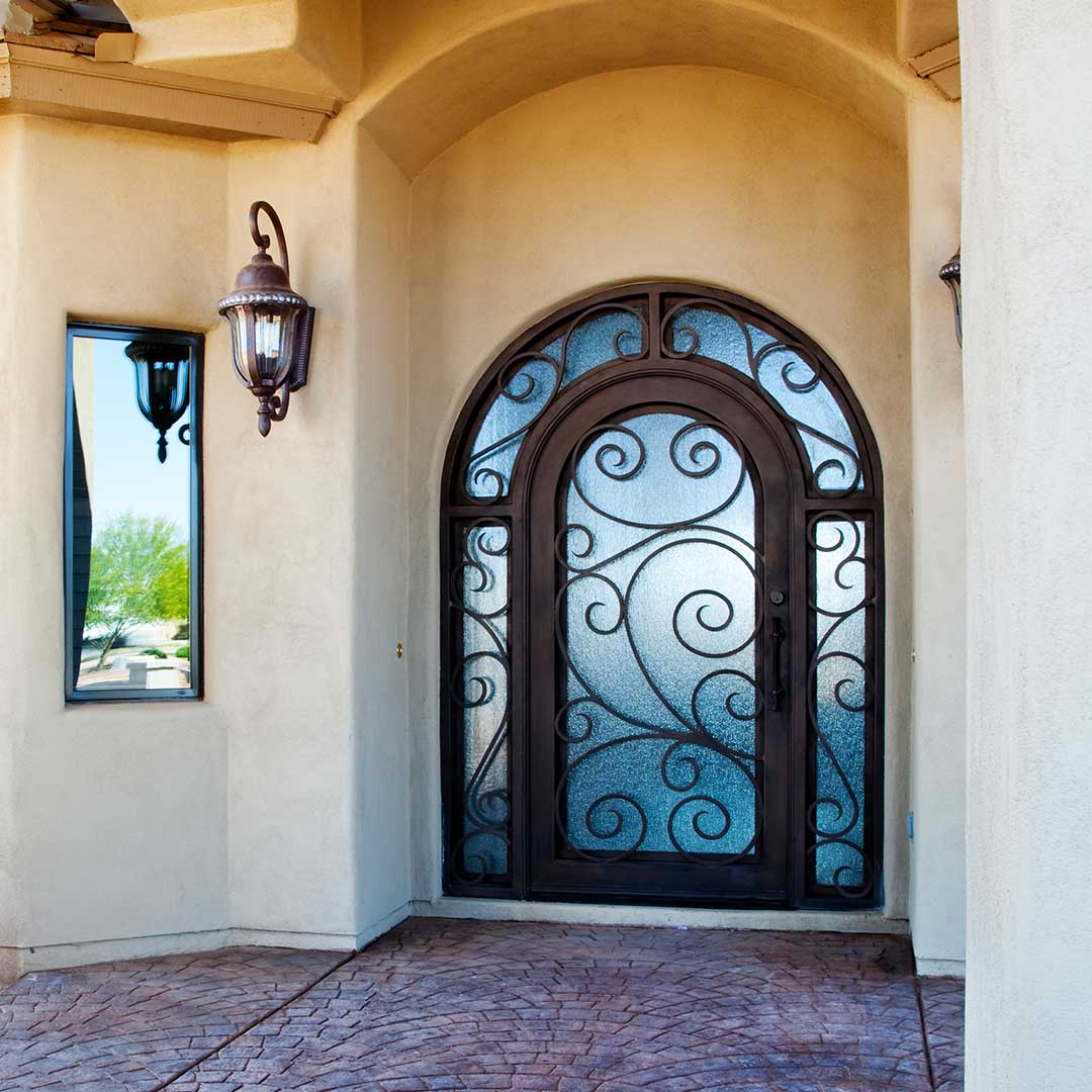First Impression Ironworks Arched Iron and Glass Entry Door with Scrolls