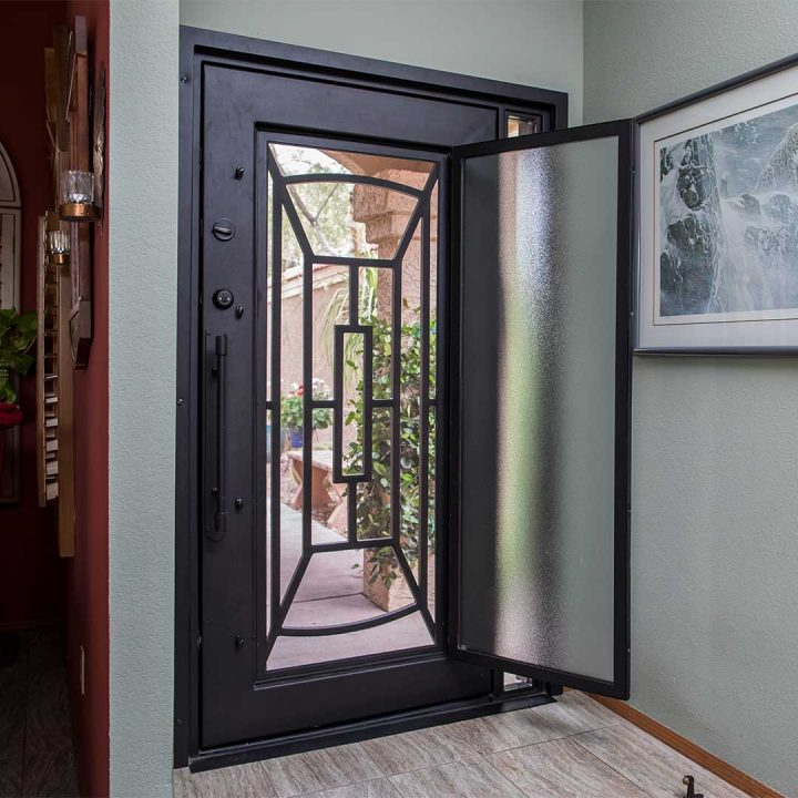 First Impression Ironworks Iron Entry Door with a glass panel that opens leaving a screen to allow for airflow