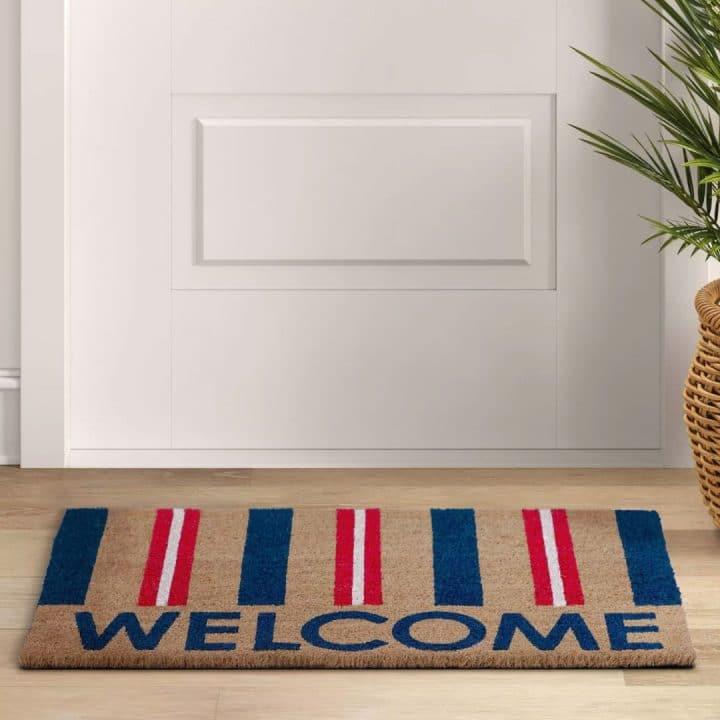 Patriotic Doormat on the ground in front of a door