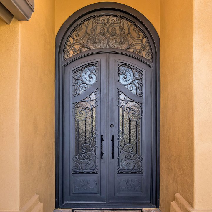 First Impression Ironworks Arched iron and Glass French Entry Doors with intricate scrolled details