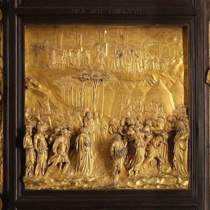 """photo of one of the gold sculpted panels from the """"Gates of Paradise"""" by Lorenzo Ghiberti."""