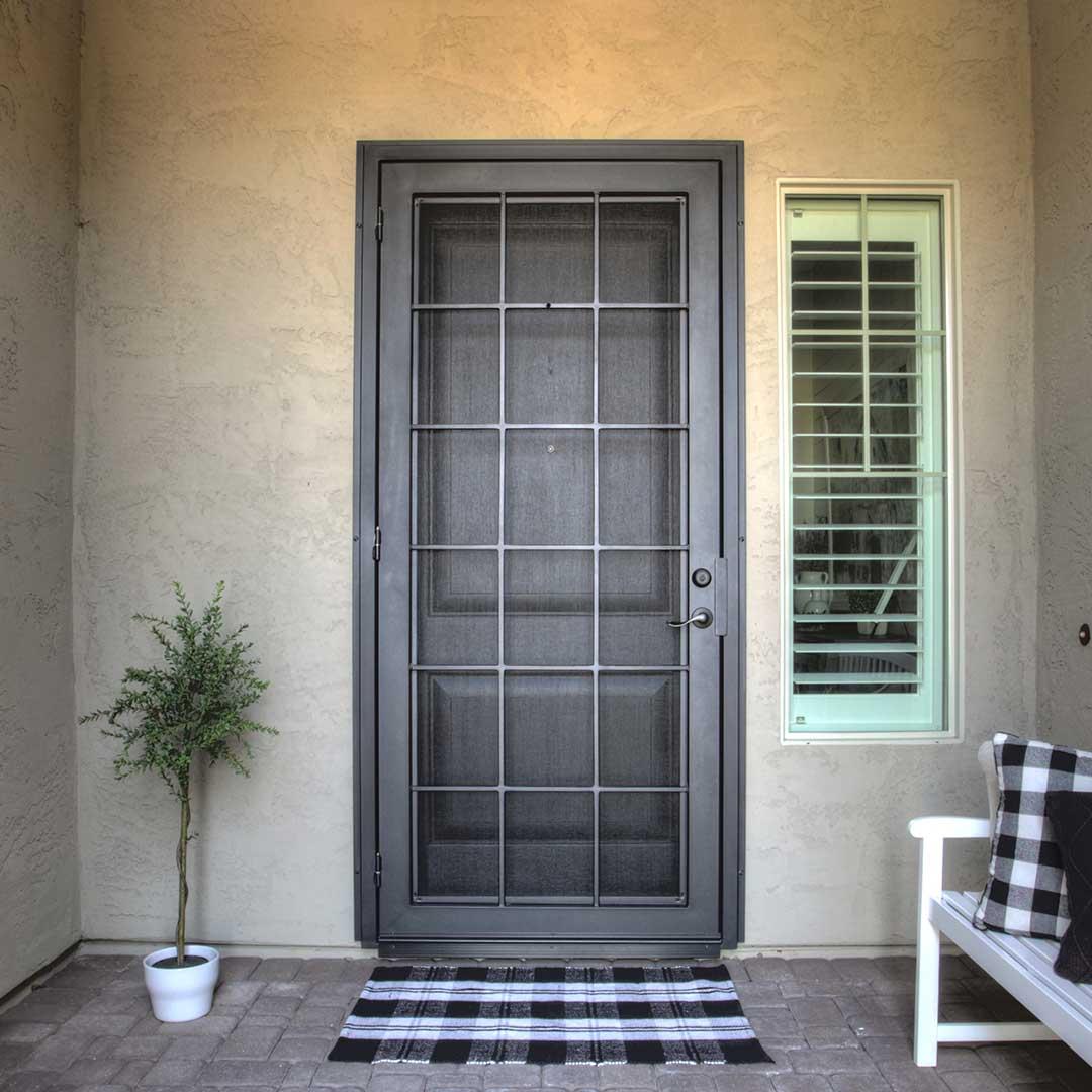 black iron security door with a grid design