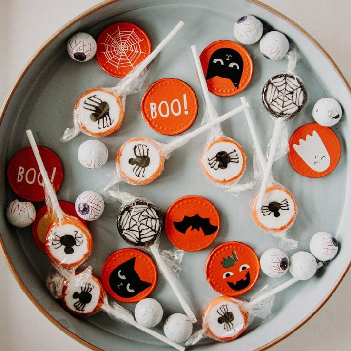 Halloween candy scattered on a round white platter