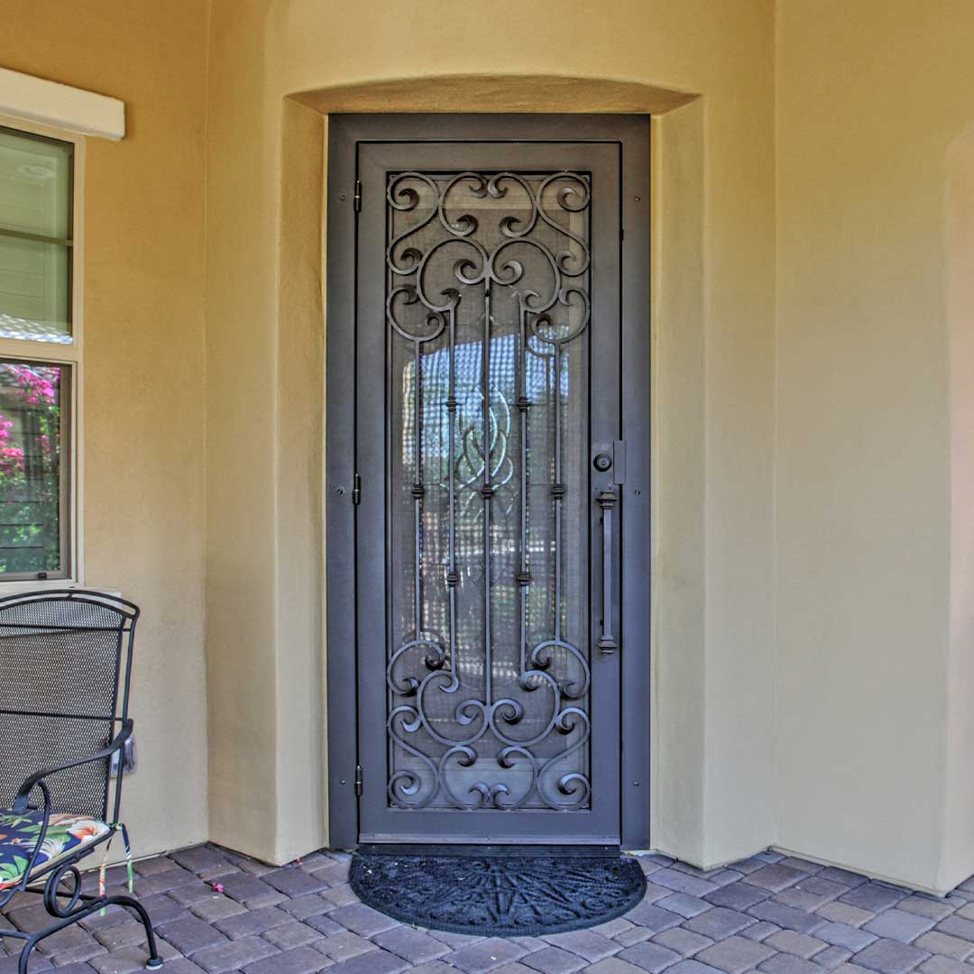 dark brown iron security door with intricate swirl designs
