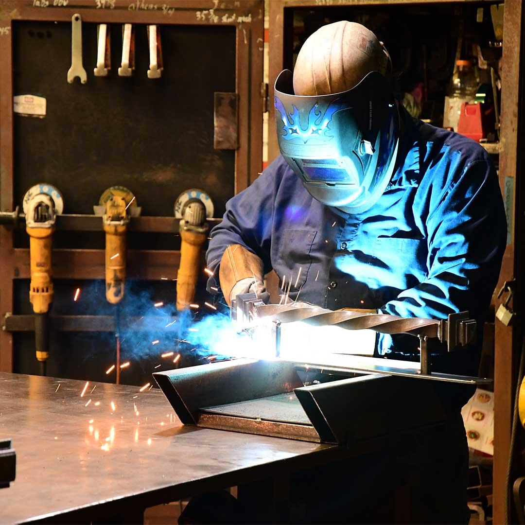First Impression Ironworks Welder working on a door