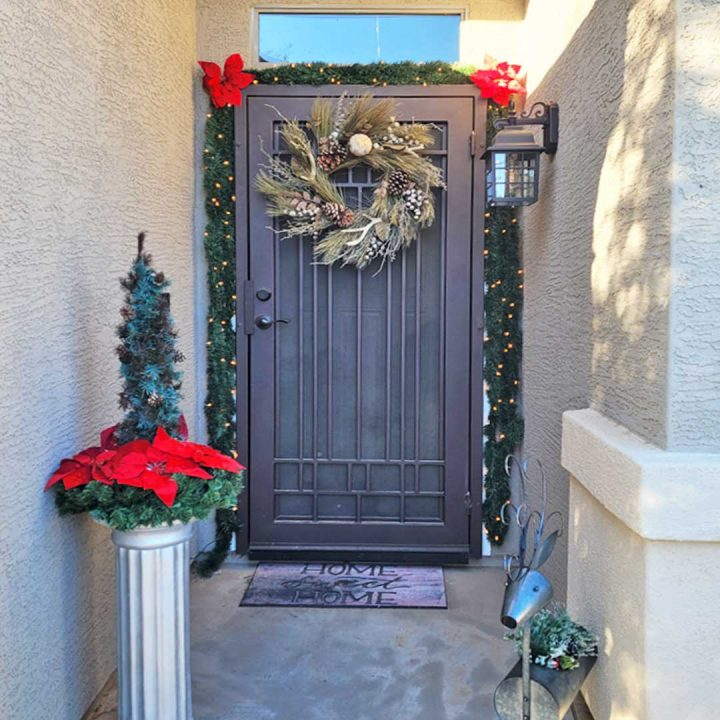 First Impression Ironworks iron security door, with holiday wreath and garland