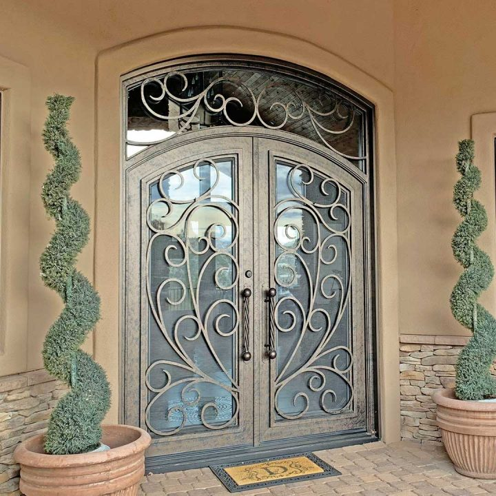 First Impression Ironworks iron and glass entry door with intricate scrollwork
