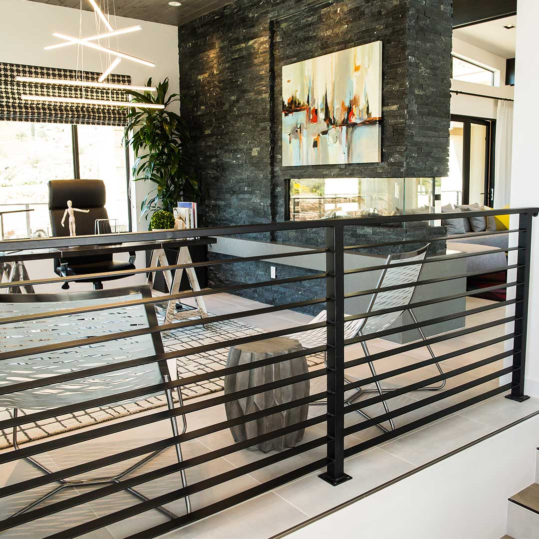 outdoor living area with a black modern railing