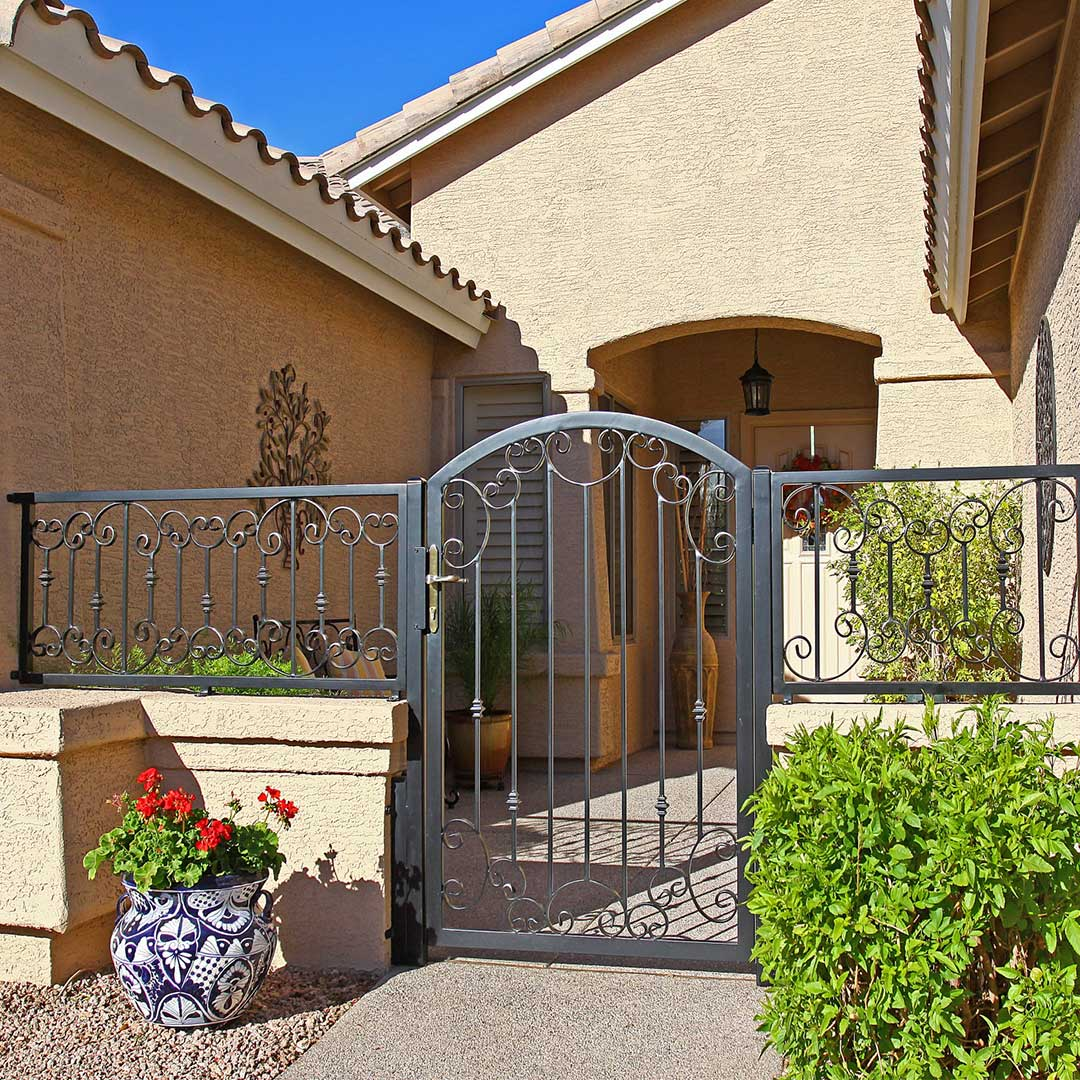 Front entry iron railing with a matching iron gate