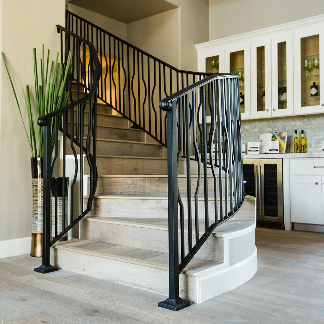 Curved staircase with a black iron railing