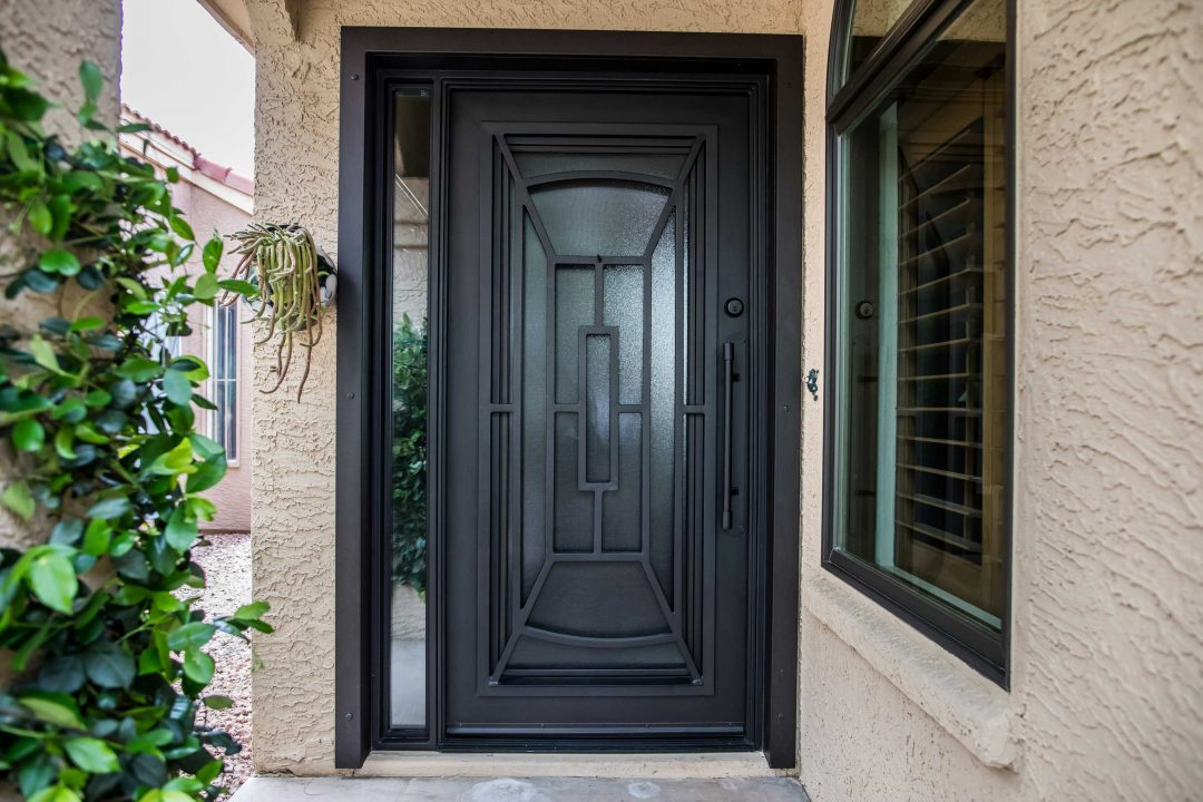 First Impression Ironworks black iron and glass entry door with a window sidelight