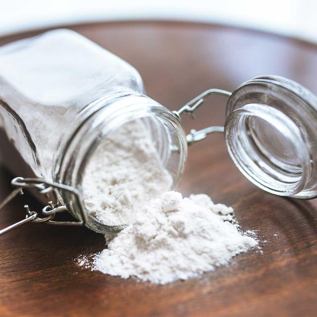 baking soda falling out of a jar