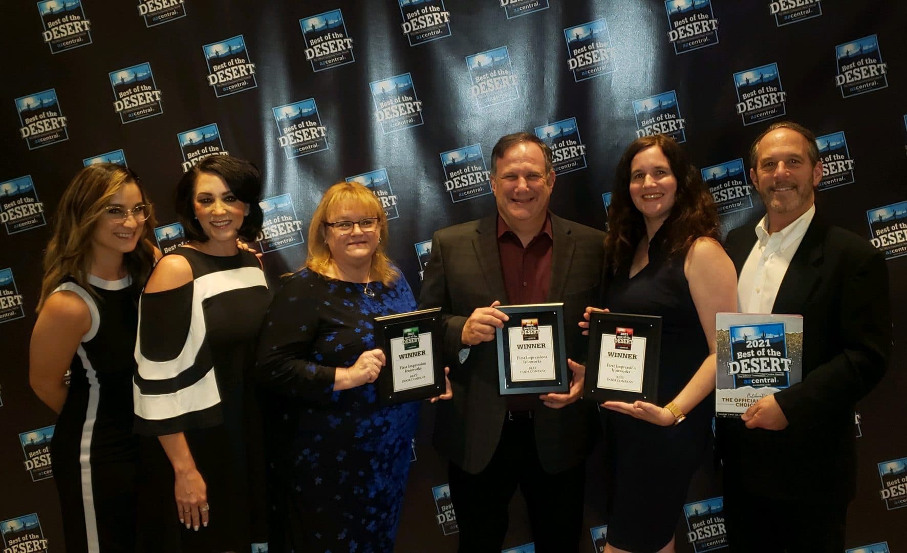 First Impression Ironworks team members holding all 3 of the Best of the Desert awards