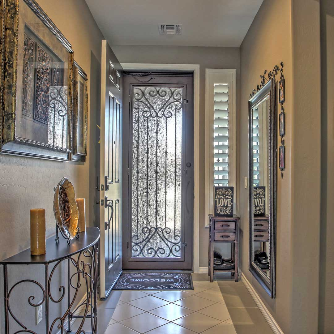 First Impression Ironworks Security Door open to allow for air flow through a home